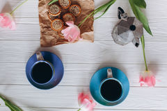 Pink tulips and coffee cups. Mother`s Day or Women`s Day Stock Photo