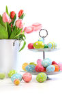 Pink tulips with colorful easter eggs on white Stock Photo