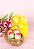 Pink tulips, easter eggs and gift box Stock Image