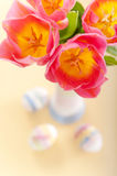 Pink tulips, Easter eggs and yarn wrapped bottle Stock Photography