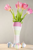 Pink tulips, Easter eggs and yarn wrapped bottle Royalty Free Stock Photography