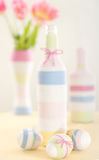 Pink tulips, Easter eggs and yarn wrapped bottle Stock Photos