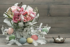 Pink tulips, feathers, butterflies and easter eggs Royalty Free Stock Photos