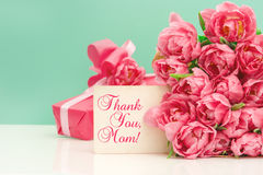 Pink tulips, gift ang greeting card. Mothers Day concept. Pink tulips, gift ang greeting card with sample text Thank You, Mom! Mother's Day concept stock photo
