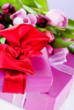 Pink tulips and gift boxes stock image