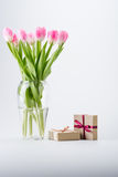 Pink tulips and gifts Stock Photos