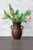 Pink tulips in a jug. Still life with a bouquet of pink tulips Stock Photo
