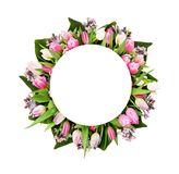 Pink tulips and lilac flowers in round frame. With white circle for text isolated on white background. Flat lay. Top view Royalty Free Stock Photo