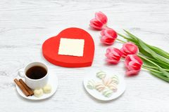 Pink tulips, mug of coffee and marshmallow. Red heart shaped gif Stock Photography
