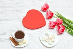 Pink tulips, mug of coffee and marshmallow. Red heart shaped gif Royalty Free Stock Image