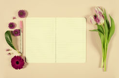 Pink tulips and notebook Royalty Free Stock Image