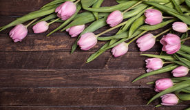 Pink tulips on old wooden background. Spring flowers card with c Royalty Free Stock Image