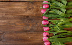 Pink tulips over shabby white wooden table Royalty Free Stock Photography