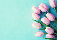 Pink tulips over wood Royalty Free Stock Image