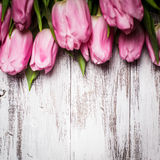 Pink tulips over wooden table Stock Photography