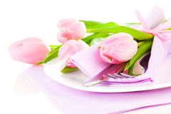 Pink tulips in a plate, on a white background. Royalty Free Stock Photo