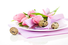 Pink tulips with quail eggs in a plate,. On a white background.  romantic still life with fresh flowers Royalty Free Stock Photos