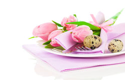Pink tulips with quail eggs in a plate,. On a white background.  romantic still life with fresh flowers Stock Photography