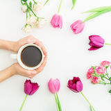 Pink tulips, roses and black coffee on white background. Flat lay. Top view. Valentines Day background. Royalty Free Stock Photos