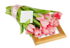 Pink tulips with satin ribbon on the wooden frame with postcard Royalty Free Stock Photography