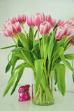 Pink tulips in a vase with a pink easter bunny Stock Photography