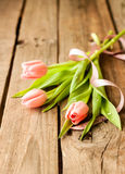 Pink tulips on vintage wood - background Royalty Free Stock Images