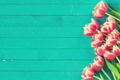 Pink tulips on vintage wooden background Stock Photo