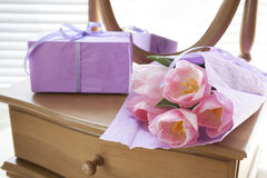Pink tulips in violet paper, gift and mirror Stock Images