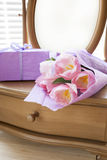 Pink tulips in violet paper, gift and mirror Stock Photos