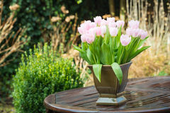 Pink tulips on a wet garden table Stock Photography
