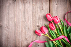 Pink tulips on wooden background Stock Photos