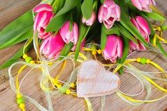 Pink tulips wooden heart Stock Photo