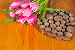 Pink tulips wooden heart Royalty Free Stock Image