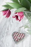 Pink tulips and wooden heart, text space Stock Image