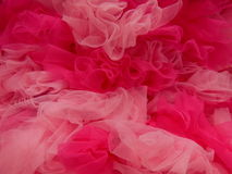 Pink Tulle. This is a large gathering of the fabric Tulle, used for crafts, ballet outfits and in the days of long ago, the 50's can-can's Stock Photography