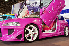 Pink tuned car stock photos