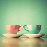 Pink and Turquoise tea cups Stock Photos
