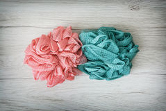 Pink and turquoise washcloths on the wooden background Royalty Free Stock Photos