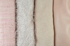 Pink twisted cane, woolen, cotton and leather fabrics Royalty Free Stock Photos