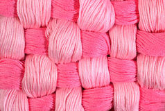 Pink twisted skeins of floss as background texture Stock Images