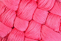 Pink twisted skeins of floss as background texture Royalty Free Stock Photography