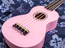 Pink Ukulele over Blue Hawaiian Shirt Stock Photo