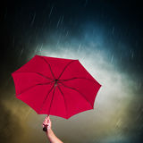 Pink Umbrella. Opened pink umbrella under dark sky with falling rain Royalty Free Stock Photography