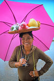 Woman Carries Fruit Basket on Head Royalty Free Stock Photos