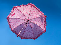Pink umbrella in the sky Stock Image
