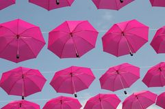 Pink umbrellas. Flying in the sky Royalty Free Stock Photo