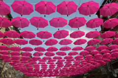 Pink umbrellas. Flying in the sky Royalty Free Stock Images