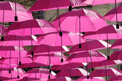 Pink umbrellas. Flying in the sky Stock Photo