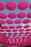 Pink umbrellas. Flying in the sky Royalty Free Stock Photography