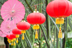 Pink umbrellas and chinese lanterns (2) Royalty Free Stock Images